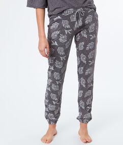 Pantalon imprimé feuille gris.