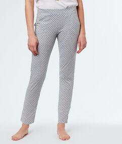 Pantalon à pois gris.