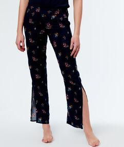 Kalhoty skvětinovým potiskem bleu.