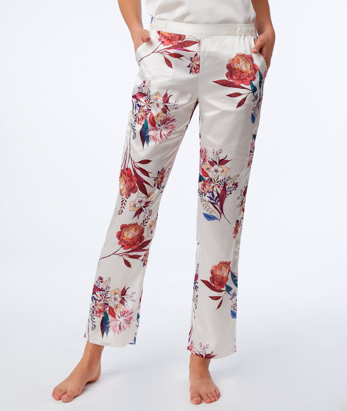 Kalhoty s květovaným potiskem béžová.